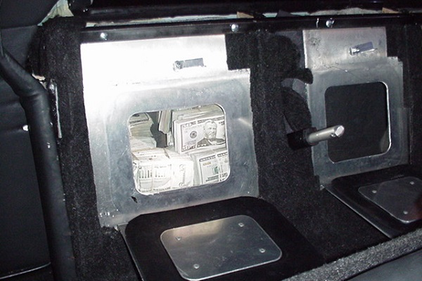 Trap compartment inside limo to hide drugs and money